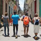 Team walking along Havana's street
