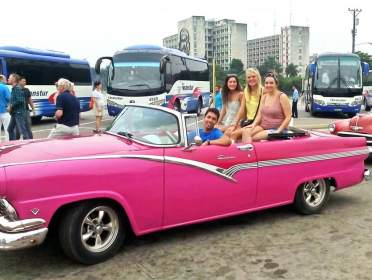 Tour guide Armando Lee Socarras with 3 happy customers in his Ford Fairline '56 that he and his father painted pink only recently.